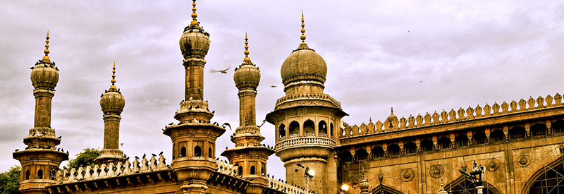Image of the towering minarets of the famous Mecca Masjid,the largest mosque in Hyderabad on a cloudy and dramatic evening
